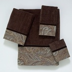 Luxurious velour decorative towel is embellished with a woven classic paisley border design in browns and blues. The border is finished off with a coordinating brown velvet ribbon.