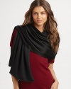 Hand-woven and hand-dyed cashmere/silk wrap reverses from a matte to a shine. Woven satin ball fringe 78L X 22W Imported