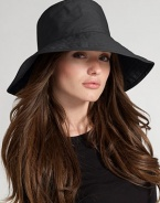 Floppy, water-resistant coated cotton is stylish for rainy days. Signature logo detail Brim, about 4¼ wide One size fits most Cotton; spot clean Imported