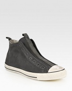 Canvas high-top design with a contrasting rubber toecap and sole, modernized by a laceless front. Leather liningPadded insoleRubber soleImported
