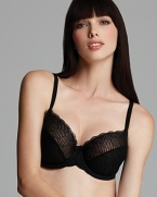 This full figure underwire bra from Wacoal features mesh patterned soft cups and scalloped lace trim detail for a feminine finish. Style #855117