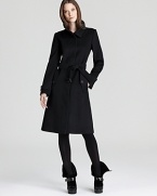 A luxe wool and cashmere fabric lends cozy appeal to the sleek Burberry London Baswick coat--clean lines and a tailored silhouette make for a sophisticated staple.