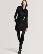 Burberry London's military-inspired coat flaunts a belted waist for a sleek, slimming silhouette.