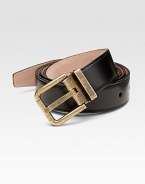 A fine calfskin leather belt finished with a distressed metal buckle. About 1¾ wide Made in Italy