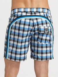 Quick-drying swim trunks, in a vivid check print, are accented by a lace-up waist and signature rainbow detail across the back and down the leg.Drawstring waistRear flap pocketInseam, about 7NylonMachine washImported