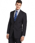 Bored with basic black? In a cool, crisp navy, this Calvin Klein blazer is change you've been waiting for.