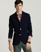 The contrast buttons of this handsome 2-button blazer add whimsy to your refined-and-relaxed look.