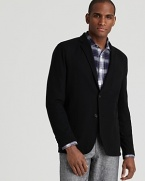 This handsome blazer from Michael Kors polishes up your look no matter where you go.