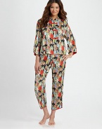 Asian-inspired pajamas look and feel like silk, yet are easily washable. Mandarin collared top Contrast button-and-loop closures Wide three-quarter sleeves with slit cuffs Side slits at hem Full length pant with drawstring waist Piped slit cuffs Polyester; machine wash Imported