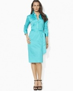A classic shirtdress is rendered in bold cotton sateen with a self-belt waist for a figure-flattering fit.
