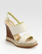Backed by an adjustable slingback strap, this strappy leather essential has a wooden wedge and earthy espadrille trim. Wooden and braided hemp wedge, 4½ (140mm)Wooden and braided hemp platform, 1 (25mm)Compares to a 3½ heel (90mm)Leather upperLeather lining and solePadded insoleMade in ItalyOUR FIT MODEL RECOMMENDS ordering one size up as this style runs small.