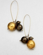 A lovely mix of gunmetal-finished and 18k goldplated spheres in a cluster design. Brass18k goldplated brassLength, about 2.75French wire backMade in USA