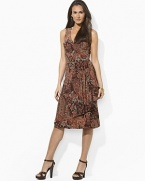 Smooth paisley jersey flatters the body in a feminine A-line silhouette with an elegant cross-wrap neckline.