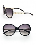 Chic round style with python printed leather accented temples on a lightweight, plastic frame. Available in black/ivory python/rose gold with smoke gradient lens. Python printed leather and logo accented temples100% UV protectionMade in Italy