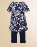 Tee-shirt comfort to wear as a dress or a tunic, in a graceful outlined floral print on subtly slubbed cotton knit.Boat necklineElbow-length sleevesPullover stylingSlightly flared shapeCottonMachine washImported