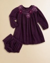 Plush, long-sleeve style with a smocked neckline and pretty flowers for an extra special touch. Round neckSmocked necklineLong sleeves with elastic cuffsButton back92% polyester/8% spandexHand wash or dry cleanImported