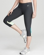 Made with Dri-FIT technology to wick away moisture, these body-contouring Nike capri pants combine style and comfort for effortless workout-chic.
