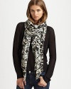 A striking ikat print refreshes this lengthy, lightweight scarf. ViscoseAbout 60 X 60Dry cleanImported