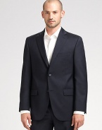 EXCLUSIVELY OURS. An essential look that travels as well as it wears, tailored in sophisticated wool super 120s that never goes out of style. Two-button closure Chest welt, waist flap pockets About 30¼ from shoulder to hem Loro Piana serge wool; dry clean Imported Additional Information Men's Suits Size Guide