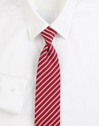 Some things are timeless, and this classic tie, woven in Italian silk with contrast stripes, is one of them. About 3 wideSilkDry cleanMade in Italy