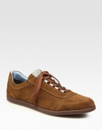 Sporty styling in supple Italian sueded calfskin elevates your casual wardrobe.Padded insoleRubber soleMade in Italy