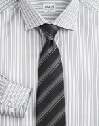 A sartorial standard in beautifully crafted, striped Italian silk. Silk Dry clean Made in Italy