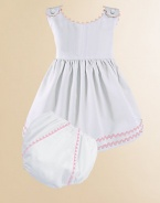 An adorable look for a picnic or a portrait in lightweight cotton piqué with pretty rick rack trim and a matching diaper cover. Covered button shoulder closures High waist Cotton; machine wash Made in USA Please note: Diaper cover cannot be personalized.FOR PERSONALIZATION Select a quantity, then scroll down and click on PERSONALIZE & ADD TO BAG to choose and preview your personalization options. Please allow 2 to 3 weeks for delivery.