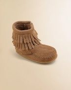 This ultra-comfortable, ultra-stylish boot is made in plush suede with a convenient side zip and layers of fringe for peace, love and fashion for your little one.Zip-upSuede upperRubber solePadded insoleImported