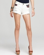 Boasting eclectic-print pockets, these artfully distressed Free People denim shorts will take you from beach jaunt to music festival in laid-back bohemian style.