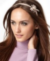 Sparkle a little more this season. Add a festive touch to day or night ensembles with this darling bow headband by Weberline Couture.