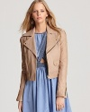 Cast in camel, this buttery Juicy Couture leather jacket is the perfect layering piece for the season. Top off maxis with the the sleek style for a look echoes downtown cool.