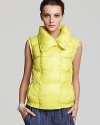 A quintessential layering piece bulks up and blasts off in a vibrant citrus hue on this Vince puffer vest, perfect for brightening up dreary winter days.
