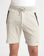 A sophisticated presence that doesn't sacrifice comfort, these cotton knit sweat shorts are sharpened by contrast detail at the pockets and signature logo detail.Drawstring waistSide slash, back welt pocketsInseam, about 6CottonMachine washImported