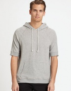 Sporty, hooded pullover perfect for casual weekend wear, in finely blended cotton knit for added warmth and comfort.Attached drawstring hoodFront kangaroo pockets95% cotton/5% polyurethaneMachine washImported