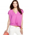 The ruffle overlay adds an unexpected edge to this RACHEL Rachel Roy boxy top -- perfect over the season's skinny jeans!