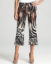 Make a fierce style statement in BASLER's animal print pants. A cropped length lends a modern finish.