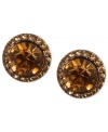 Smoky sophistication stands out on Givenchy's stud earrings. A light Colorado topaz glass stone is surrounded by pave accents. Crafted in brown gold tone mixed metal. Approximate diameter: 1-1/2 inches.