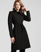 Burberry London exudes timeless chic with dramatic flair in this sleek trench coat. Pair the perennial style with all your favorite fall looks, day or night.