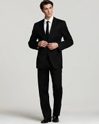 BOSS Black Pasolini Movie Suit. Two-button jacket with side vents. Four inner welt pockets, plus front flap and chest pockets. Boss Hugo Boss label sewn inside. Fully lined, with sleeve lining in rayon. Trousers are flat front, lined to knee with unfinished hem.