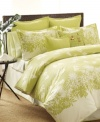 It's always greener. A modern print of botanical silhouettes transforms your room into a tropical oasis with Tommy Bahama's Paradise Isle comforter set. Featuring pure cotton. Includes white bedskirt finished with green trim. (Clearance)