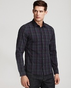 This cotton button down has a crumpled texture allover, a modern fit and Burberry's signature check pattern allover.