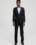 Suitable for the boardroom and the best man, this pinstripe suit in lightweight virgin wool is a wardrobe staple. Fully lined jacket has notched lapel, front flap pockets and 2-button closure. Pant has flat front, black slit pockets and zip fly.