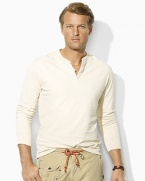 A handsome long-sleeved Henley shirt is crafted from smooth, soft cotton duofold with a subtle heathered pattern for a look imbued with vintage character.