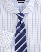 A slim, tailored fit in cotton with fine blue checks. Buttonfront Spread collar Cotton Dry clean Imported