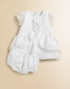 Crafted in the most lavish cotton, this angelic silhouette is adorned with cascading ruffles.Jewel necklineShort sleevesBack zipperDouble-tiered ruffle hemCottonDry cleanImported