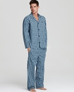 Get a restful night's sleep in these crisp cotton pajamas, cool against the skin for relaxed comfort.