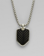 A cool and casual touch features a sterling silver dogtag-style pendant lined in chevron-textured onyx. From the Chevron Collection Black onyx Sterling silver Pendant, about 1 long Chain length, about 22 Lobster clasp Imported