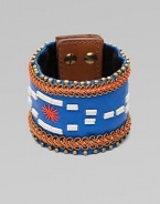 A wide cuff of bright leather, edged with golden beads and chains, stitched in colorful cord, with a center bugle-bead design.LeatherGoldtoneCotton backingLength, about 8½Width, about 2¾Stud snap closureImported