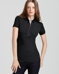 Timeless and seasonless--the makings of a staple. Do basics Brit-style with this classic polo. From Burberry Brit.