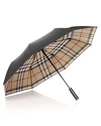 Shield yourself from inclement weather with an iconic umbrella from Burberry.
